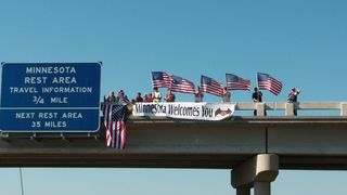 Minnesotans greet the riders from bridges