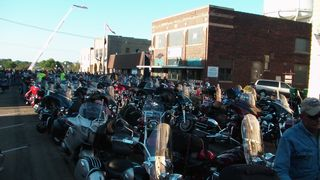 Downtown Albert Lea, MN. Packed with bikes and bikers. See that aerial ladder? Yeah- a fireman climbed and took pics. Hope to get some.